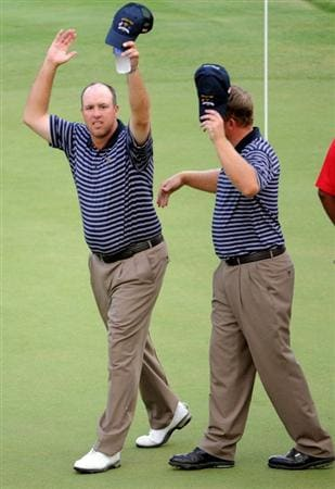 LOUISVILLE, KY - SEPTEMBER 20:  Boo Weekley and J.B. Holmes of the USA team celebrate after their 2 & 1 victory during the afternoon four-ball matches on day two of the 2008 Ryder Cup at Valhalla Golf Club on September 20, 2008 in Louisville, Kentucky.  (Photo by Harry How/Getty Images)