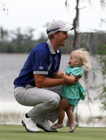 ORLANDO, FL - MARCH 17:  Henrik Stenson of Sweden and the Lake Nona Team picks up his daughter Emma at the 18th hole during the second day of the 2009 Tavistock Cup at the Lake Nona Golf and Country Club, on March 17, 2009 in Orlando, Florida  (Photo by David Cannon/Getty Images)