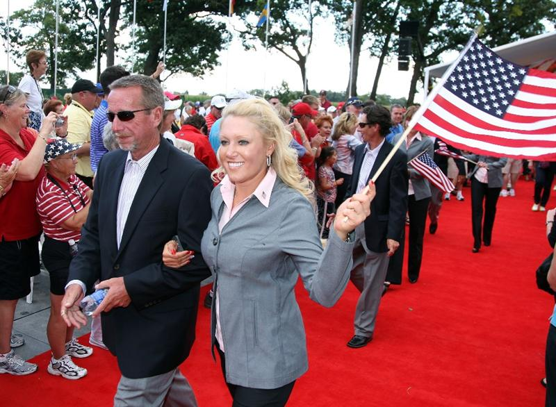 SUGAR GROVE, IL - AUGUST 20: Natalie Gulbis of the USA with her caddie Greg Sheridan during the Opening Ceremony for the 2009 Solheim Cup Matches, at the Rich Harvest Farms Golf Club on August 18, 2009 in Sugar Grove, Ilinois  (Photo by David Cannon/Getty Images)