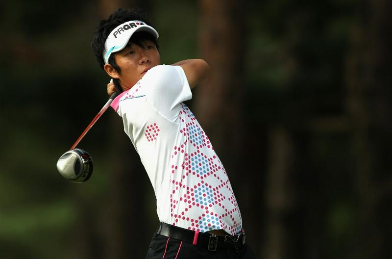 KAWAGOE CITY, JAPAN - OCTOBER 08:  Yosuke Asaji of Japan watches his tee shot on the 12th hole during the second round of the 2010 Asian Amateur Championship at Kasumigaseki Country Club on October 8, 2010 in Kawagoe City, Japan.  (Photo by Streeter Lecka/Getty Images)