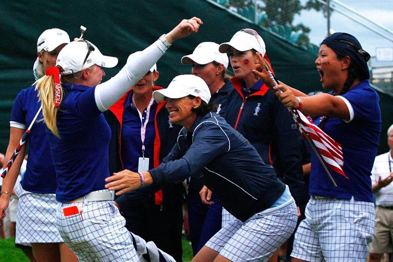 SUGAR GROVE, IL - AUGUST 22:  Morgan Pressel is greeted by Juli Inkster, Paula Creamer and Christina Kim and other members of the of the U.S. Team on the 18th green during the saturday afternoon foursomes matches at the 2009 Solheim Cup at Rich Harvest Farms on August 22, 2009 in Sugar Grove, Illinois.  (Photo by Scott Halleran/Getty Images)