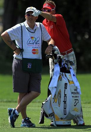 ORLANDO, FL - MARCH 24:  Ian Poulter of England with is caddie Terry Mundy before he played his second shot at the 1st hole during the first round of the 2011 Arnold Palmer Invitational presented by Mastercard at the Bay Hill Lodge and Country Club on March 24, 2011 in Orlando, Florida.  (Photo by David Cannon/Getty Images)