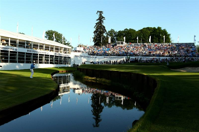 VIRGINIA WATER, ENGLAND - MAY 23:  Robert Karlsson of Sweden chips to the 18th green during the final round of the BMW PGA Championship on the West Course at Wentworth on May 23, 2010 in Virginia Water, England.  (Photo by Richard Heathcote/Getty Images)