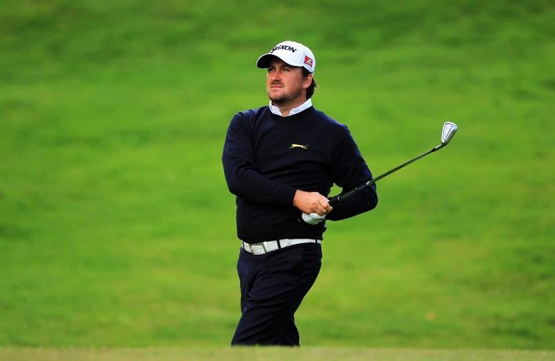 VIRGINIA WATER, ENGLAND - MAY 27:  Graeme McDowell of Northern Ireland hits his 3rd shot on the 18th hole during the second round of the BMW PGA Championship at the Wentworth Club on May 27, 2011 in Virginia Water, England.  (Photo by David Cannon/Getty Images)