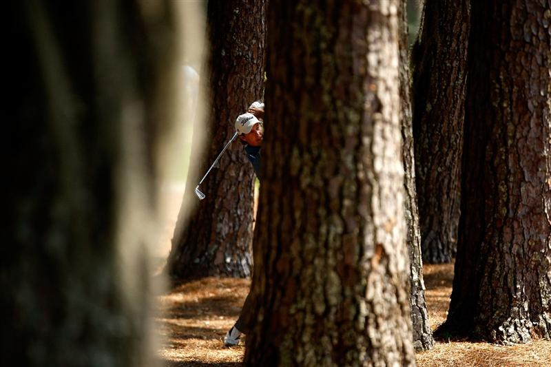 HILTON HEAD ISLAND, SC - APRIL 17:  Parker McLachlin hits a shot from the trees during the second round of the Verizon Heritage at Harbour Town Golf Links on April 17, 2009 in Hilton Head Island, South Carolina.  (Photo by Streeter Lecka/Getty Images)