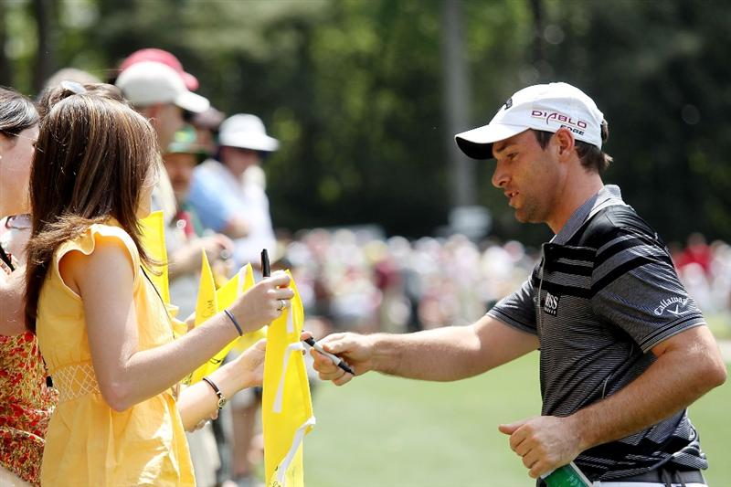 AUGUSTA, GA - APRIL 07:  Oliver Wilson of England signs autographs for fans during the Par 3 Contest prior to the 2010 Masters Tournament at Augusta National Golf Club on April 7, 2010 in Augusta, Georgia.  (Photo by Andrew Redington/Getty Images)