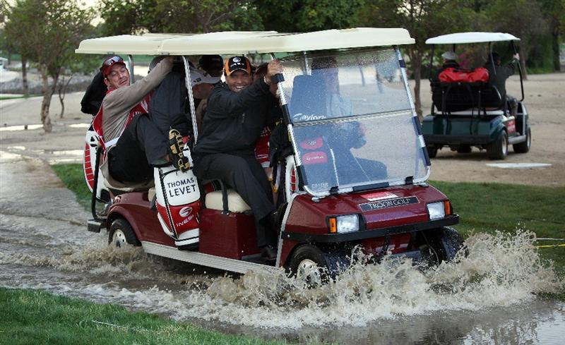 ABU DHABI, UNITED ARAB EMIRATES - JANUARY 15:  Thomas Levet of France makes his way back to the club house in a buggy as rain halts play during the first round the Abu Dhabi Golf Championship at the Abu Dhabi Golf Club on January 15, 2009 in Abu Dhabi, United Arab Emirates.  (Photo by Ross Kinnaird/Getty Images)
