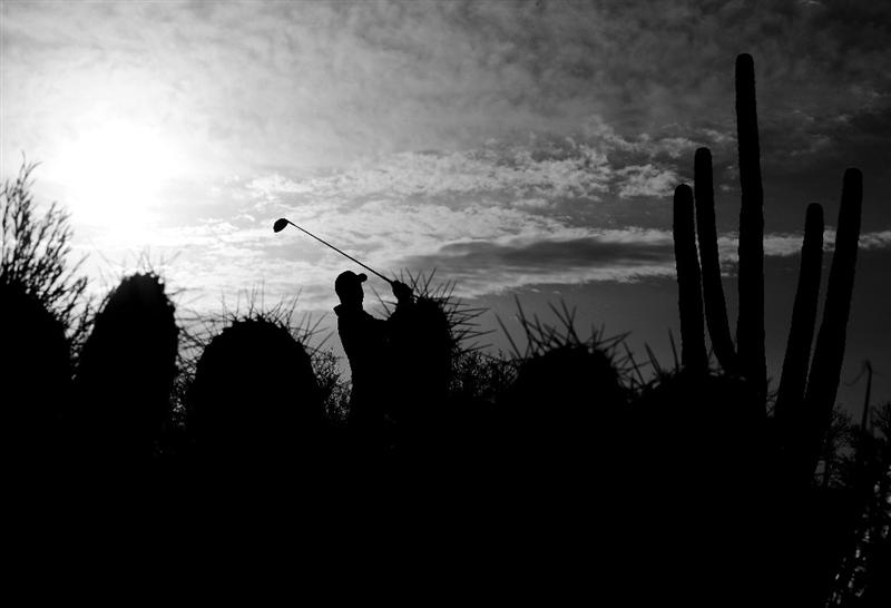 MARANA, AZ - FEBRUARY 20:  (EDITORS NOTE: Image has been converted to black and white.) Stewart Cink plays his tee shot on the second hole during round four of the Accenture Match Play Championship at the Ritz-Carlton Golf Club on February 20, 2010 in Marana, Arizona.  (Photo by Stuart Franklin/Getty Images)