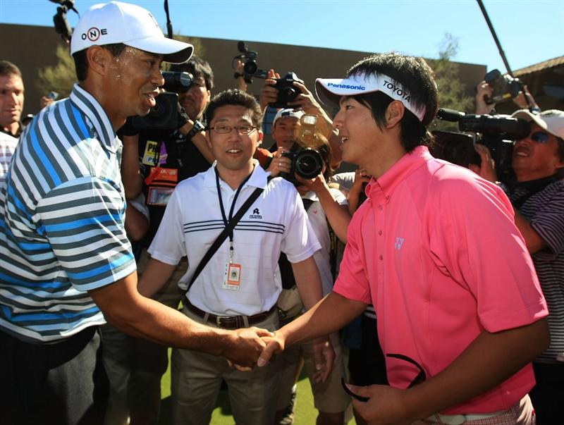 MARANA, AZ - FEBRUARY 24:  Tiger Woods shakes hands with Ryo Ishikawa of Japan during a practice round prior to the start of the Accenture Match Play Championship at the Ritz-Carlton Golf Club at Dove Mountain on February 24, 2009 in Marana, Arizona.  (Photo by Scott Halleran/Getty Images)