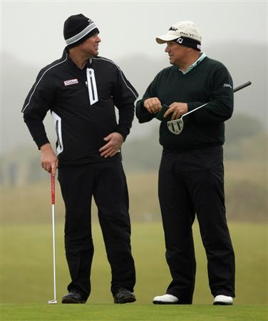 KINGSBARNS, SCOTLAND - OCTOBER 08:  Shane Warne, former Australian cricketer,(left) and his playing partner Peter O'Malley of Australia in action during the second round of The Alfred Dunhill Links Championship at Kingsbarns Golf Links on October 8, 2010 in Kingsbarns, Scotland.  (Photo by Andrew Redington/Getty Images)