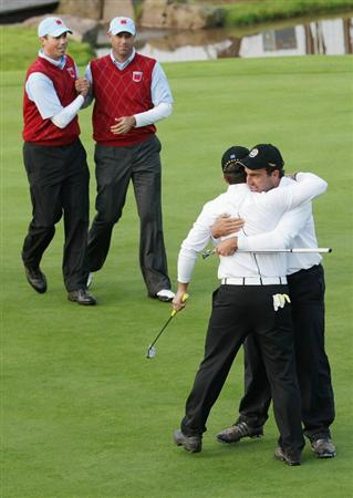 NEWPORT, WALES - OCTOBER 03:  Francesco Molinari of Europe celebrates holing a putt for victory in his match on the 18th green with Edoardo Molinari (R) as Stewart Cink (L) and Matt Kuchar of the USA look on during the  Fourball & Foursome Matches during the 2010 Ryder Cup at the Celtic Manor Resort on October 3, 2010 in Newport, Wales.  (Photo by Andrew Redington/Getty Images)