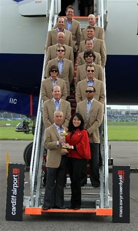 CARDIFF, WALES - SEPTEMBER 27:  In this handout image provided by Ryder Cup Europe, USA team captain Corey Pavin poses with his wife Lisa Pavin and the USA team after arriving at Cardiff Airport prior to the start of the 2010 Ryder Cup on September 27, 2010 in Cardiff, Wales.  (Photo by Ryder Cup Europe via Getty Images)