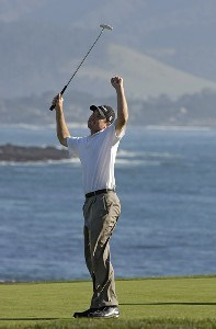 Arron Oberholser celebrates on the 18th green after winning during the final round of the  AT&T Pebble Beach National Pro-Am on Pebble Beach Golf Links in Pebble Beach, California on February 12, 2006.Photo by Marc Feldman/WireImage.com