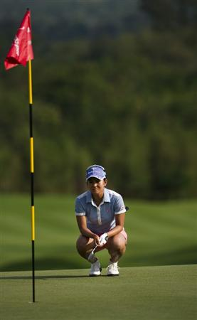 CHON BURI, THAILAND - FEBRUARY 21:  Ai Miyazato of Japan lines up a putt on the 18th green during the final round of the Honda PTT LPGA Thailand at Siam Country Club on February 21, 2010 in Chon Buri, Thailand.  (Photo by Victor Fraile/Getty Images)