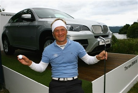 LUSS, UNITED KINGDOM - JULY 10:  Pelle Edberg of Sweden poses with the BMW X6 he won after he holed in one on the 17th hole during the First Round of The Barclays Scottish Open at Loch Lomond Golf Club on July 10, 2008 in Luss, Scotland.  (Photo by Matthew Lewis/Getty Images)