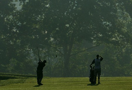 OAKMONT, PA - JUNE 14:  Jon Mills and his caddie Randy Dietz watch Mills' second shot on the first hole during the first round of 107th U.S. Open Championship at Oakmont Country Club on June 14, 2007 in Oakmont, Pennsylvania.  (Photo by Chris McGrath/Getty Images)