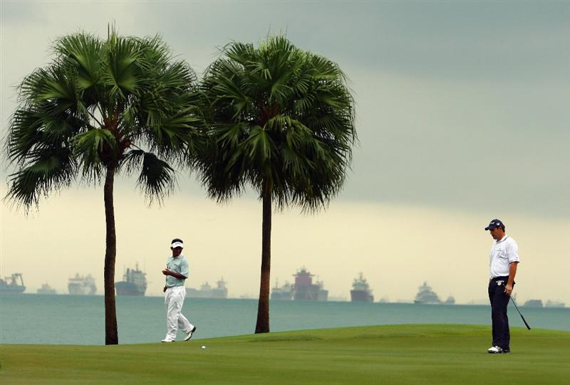 SINGAPORE - NOVEMBER 13:  Padraig Harrington of Ireland (R) looks on during the first round of the Barclays Singapore Open at Sentosa Golf Club on November 13, 2008 in Singapore.  (Photo by Ian Walton/Getty Images)