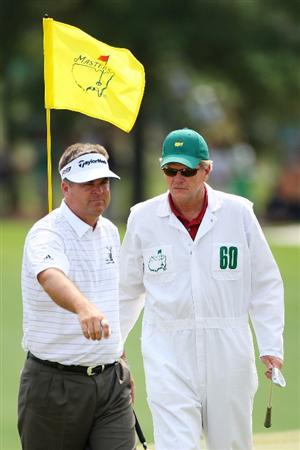 AUGUSTA, GA - APRIL 10:  Kenny Perry walks off the 18th green with his caddie Fred Sanders during the second round of the 2009 Masters Tournament at Augusta National Golf Club on April 10, 2009 in Augusta, Georgia.  (Photo by Andrew Redington/Getty Images)