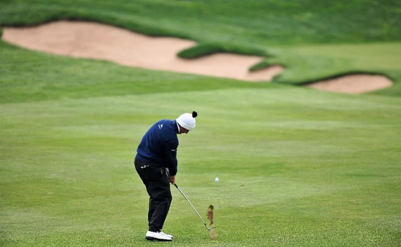 JEJU, SOUTH KOREA - APRIL 26:  Gonzalo Fernandez - Castano of Spain plays his approach shot on the 16th hole during the final round of the Ballantine's Championship at Pinx Golf Club on April 26, 2009 in Jeju, South Korea.  (Photo by Stuart Franklin/Getty Images)