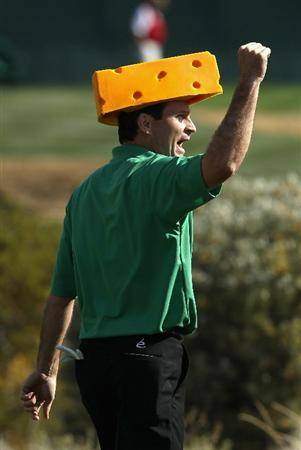 SCOTTSDALE, AZ - FEBRUARY 06:  Mark Wilson cheers as he walks down the 16th hole in a Green Bay Packers cheese head during the third round of the Waste Management Phoenix Open at TPC Scottsdale on February 6, 2011 in Scottsdale, Arizona.  (Photo by Christian Petersen/Getty Images)