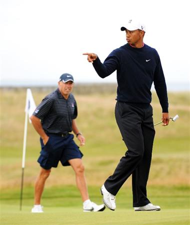 TURNBERRY, SCOTLAND - JULY 13: Tiger Woods of the USA with his caddie Steve Williams on the 15th green during the practice round of the 138th Open Championship on July 13, 2009 on the Ailsa Course, Turnberry Golf Club, Turnberry, Scotland. (Photo by Harry How/Getty Images)