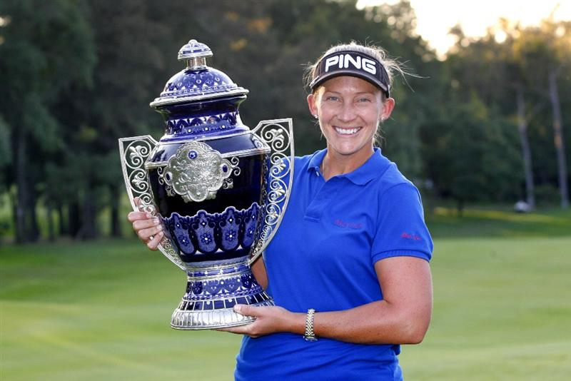 GUADALAJARA, MX - NOVEMBER 16: Angela Stanford of the United States holds the championship trophy after winning the Lorena Ochoa Invitational at Guadalajara Country Club on November 16, 2008 in Guadalajara, Mexico. (Photo by Hunter Martin/Getty Images)