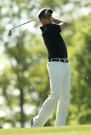 VIRGINIA WATER, ENGLAND - MAY 22:  Simon Dyson of England hits an approach shot on the 1st hole during the third round of the BMW PGA Championship on the West Course at Wentworth on May 22, 2010 in Virginia Water, England.  (Photo by Ian Walton/Getty Images)