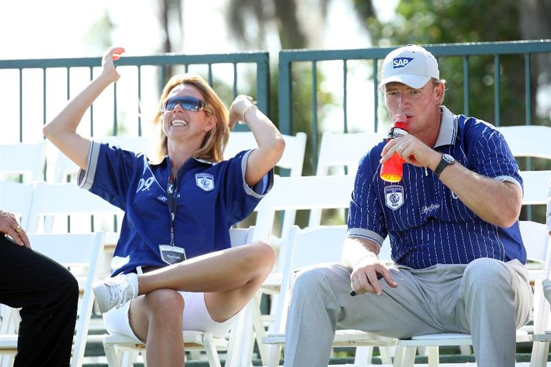 ORLANDO, FL - MARCH 16:  Ernie Els of South Africa and Lake Nona with his wife Liesl Els at the 18th hole during the first day of the 2009 Tavistock Cup at the Lake Nona Golf and Country Club, on March 16, 2009 in Orlando, Florida  (Photo by David Cannon/Getty Images)