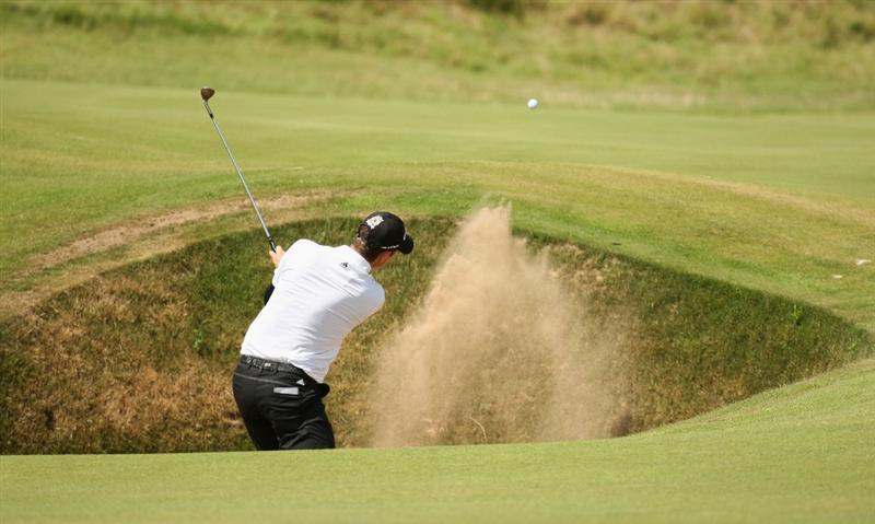 TURNBERRY, SCOTLAND - JULY 19:  Justin Rose of England hits his third shot on the 5th hole during the final round of the 138th Open Championship on the Ailsa Course, Turnberry Golf Club on July 19, 2009 in Turnberry, Scotland.  (Photo by Ross Kinnaird/Getty Images)