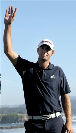 PEBBLE BEACH, CA - FEBRUARY 14:  Dustin Johnson waves during ceremonies after the final round of the AT&T Pebble Beach National Pro-Am at Pebble Beach Golf Links on February 14, 2010 in Pebble Beach, California.  (Photo by Stephen Dunn/Getty Images)