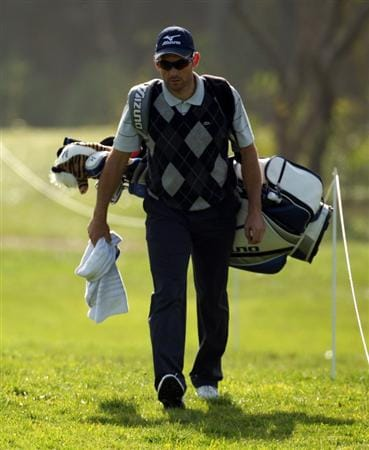 MALAGA, SPAIN - MARCH 24:  Ignacio Garrido of Spain carries his own bag after his caddie injured his back during the first round of the Open de Andalucia at the Parador de Malaga Golf Course on March 24, 2011 in Malaga, Spain.  (Photo by Ross Kinnaird/Getty Images)