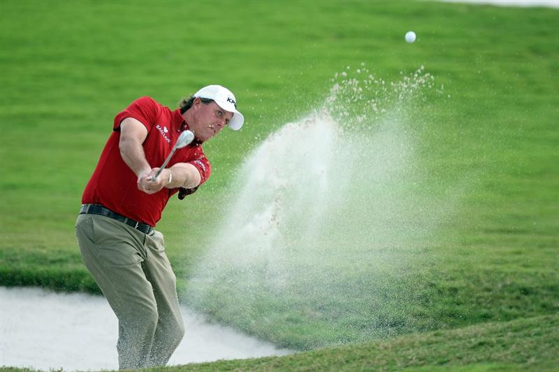DORAL, FL - MARCH 13:  Phil Mickelson of the USA hits his second shot at the 10th hole during the second round of the World Golf Championships-CA Championship at the Doral Golf Resort & Spa on March 13, 2009 in Miami, Florida  (Photo by David Cannon/Getty Images)