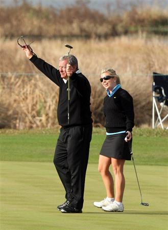 CHAMPIONS GATE, FL - DECEMBER 06: Fuzzy Zoeller of the USA celebrates a long birdie putt at the 1st hole with his daughter Gretchen Zoeller during the first round of the Del Webb Father/Son Challenge on the International Course at Champions Gate Golf Club on December 6, 2008 in Champions Gate, Florida.  (Photo by David Cannon/Getty Images)