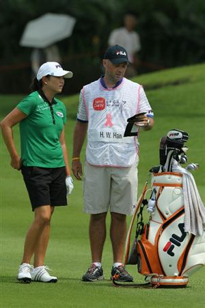 KUALA LUMPUR, MALAYSIA - OCTOBER 23 : Hee-Won Han of Korea Republic speaks to her caddie on the 9th hole during Round Two of the Sime Darby LPGA on October 23, 2010 at the Kuala Lumpur Golf and Country Club in Kuala Lumpur, Malaysia. (Photo by Stanley Chou/Getty Images)