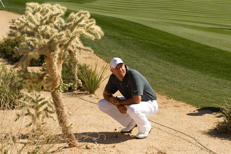 MARANA, AZ - FEBRUARY 17: Stewart Cink analyzes his lie on the second hole during round one of the Accenture Match Play Championship at the Ritz-Carlton Golf Club on February 17, 2010 in Marana, Arizona. (Photo by Darren Carroll/Getty Images)