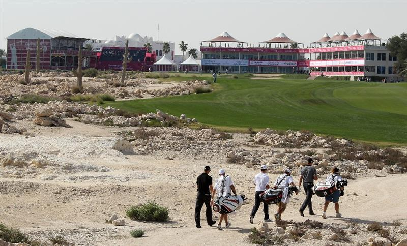 DOHA, QATAR - JANUARY 29:  Martin Kaymer of Germany, Paul Casey of England and Henrik Stenson of Sweden walks with their caddies on the 18th hole during the second round of the Commercialbank Qatar Masters at Doha Golf Club on January 29, 2010 in Doha, Qatar.  (Photo by Andrew Redington/Getty Images)