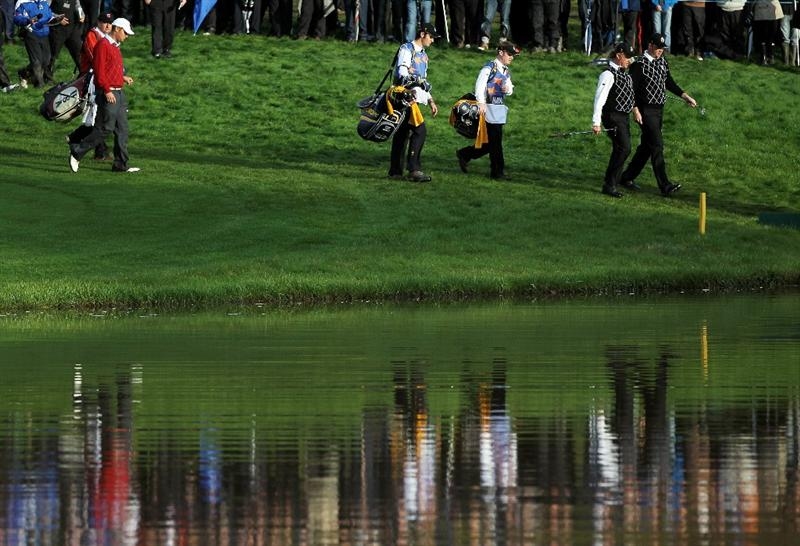 NEWPORT, WALES - OCTOBER 03:  Miguel Angel Jimenez of Europe walks down the 18th hole with Peter Hanson during the Fourball & Foursome Matches during the 2010 Ryder Cup at the Celtic Manor Resort on October 3, 2010 in Newport, Wales.  (Photo by Jamie Squire/Getty Images)