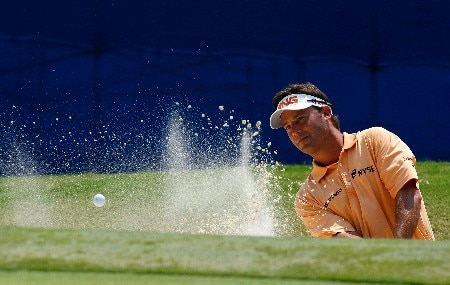 GREENSBORO, NC - AUGUST 15:  Chris DiMarco blasts out of the sand onto the 18th green during the second round of the 2008 Wyndham Championship at Sedgefield Country Club on August 15, 2008 in Greensboro, North Carolina.  (Photo by Kevin C. Cox/Getty Images)