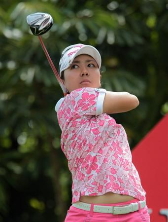 SINGAPORE - FEBRUARY 27:   Mika Miyazato of Japan watches her tee shot on the seventh hole during the final round of the HSBC Women's Champions 2011 at the Tanah Merah Country Club on February 27, 2011 in Singapore, Singapore.  (Photo by Scott Halleran/Getty Images)