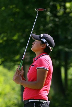 GLADSTONE, NJ - MAY 22: Yani Tseng of Taiwan reacts after missing her par putt on the eleventh hole during the third round of the Sybase Match Play Championship at Hamilton Farm Golf Club on May 22, 2010 in Gladstone, New Jersey. (Photo by Hunter Martin/Getty Images)
