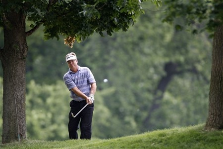GRAND BLANC, MI - JUNE 27: Kenny Perry punches out of the trees on the ninth hole during the second round of the Buick Open at Warwick Hills Golf and Country Club on June 27, 2008 in Grand Blanc, Michigan.  (Photo by Gregory Shamus/Getty Images)