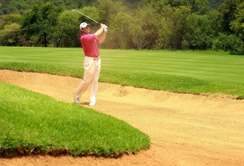 SUN CITY, SOUTH AFRICA - DECEMBER 02:  Lee Westwood of England plays out of the sixth fairway bunker during the first round of the 2010 Nedbank Golf Challenge at the Gary Player Country Club Course  on December 2, 2010 in Sun City, South Africa.  (Photo by Warren Little/Getty Images)