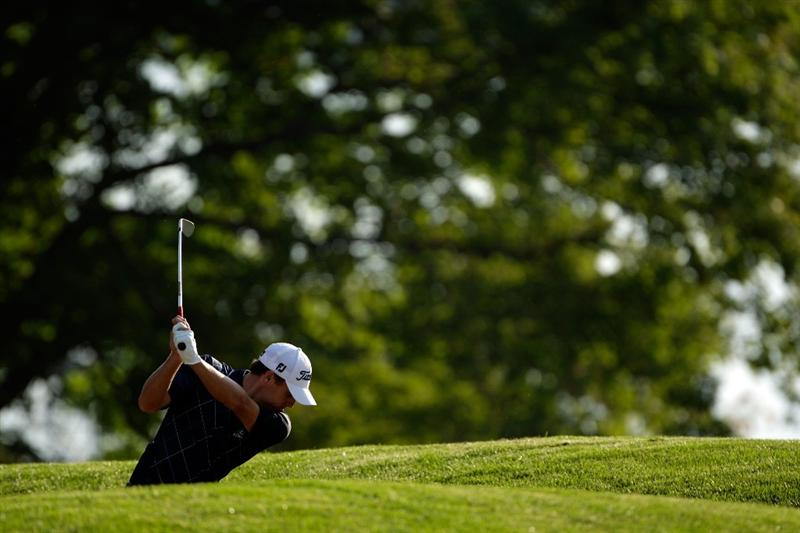 CHASKA, MN - AUGUST 13:  Nick Watney hits his approach on the tenth hole during the first round of the 91st PGA Championship at Hazeltine National Golf Club on August 13, 2009 in Chaska, Minnesota.  (Photo by Jamie Squire/Getty Images)
