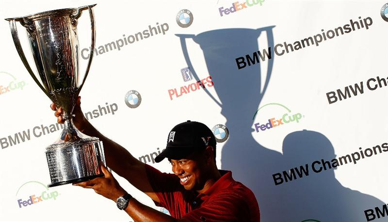 LEMONT, IL - SEPTEMBER 13:  Tiger Woods poses with the J.K. Wadley trophy after his eight-stroke victory at the BMW Championship held at Cog Hill Golf & CC on September 13, 2009 in Lemont, Illinois.  (Photo by Scott Halleran/Getty Images)