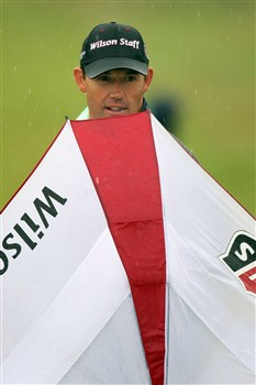 SOUTHPORT, UNITED KINGDOM - JULY 17:  Padraig Harrington of Ireland holds an umbrella as the rain fallls during the First Round of the 137th Open Championship on July 17, 2008 at Royal Birkdale Golf Club, Southport, England.  (Photo by Ross Kinnaird/Getty Images)
