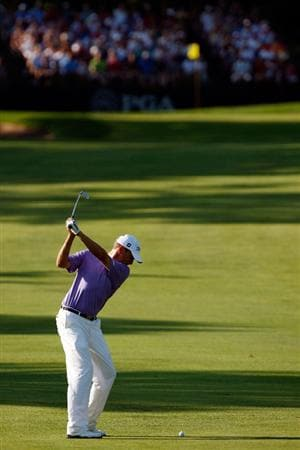 CHASKA, MN - AUGUST 14:  Davis Love III hits a shot on the 12th hole during the second round of the 91st PGA Championship at Hazeltine National Golf Club on August 14, 2009 in Chaska, Minnesota.  (Photo by Streeter Lecka/Getty Images)