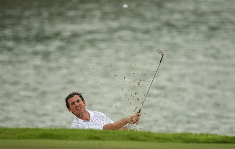 SINGAPORE - NOVEMBER 13:  Gonzalo Fernandez-Castano of Spain plays his 3rd shot on the 6th hole during the first round of the Barclays Singapore Open at Sentosa Golf Club on November 13, 2008 in Singapore.  (Photo by Ian Walton/Getty Images)