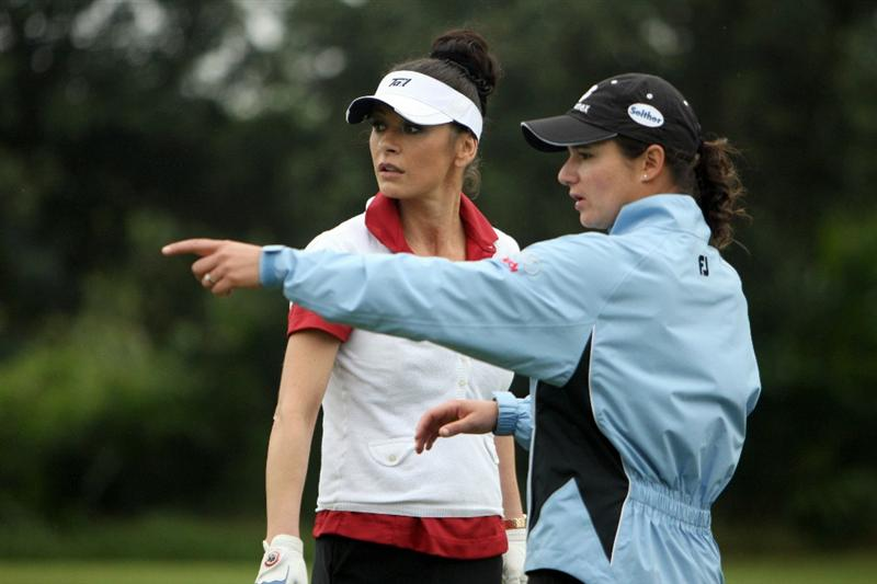 HAIKOU, CHINA - OCTOBER 27: Oscar-winning actress Catherine Zeta-Jones (L) listens to former golf world number one Lorena Ochoa of Mexico before playing a shot ahead of the inaugural Mission Hills Star Trophy on October 27, 2010 in Haikou, China. The Mission Hills Star Trophy is Asia's leading leisure liflestyle event and features Hollywood celebrities and international golf stars.  (Photo by Athit Perawongmetha/Getty Images)