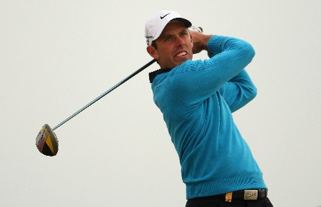 DOHA, QATAR - JANUARY 25:  Charl Schwartzel of South Africa tees off on the 11th hole during the second round of the Commercialbank Qatar Masters at Doha Golf Club on January 25, 2008 in Doha, Qatar.  (Photo by Andrew Redington/Getty Images)
