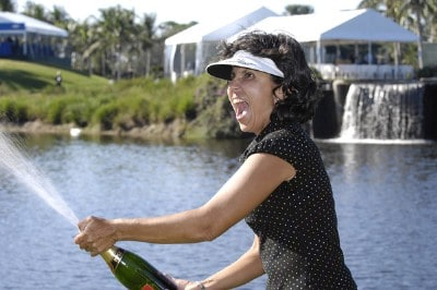 Rosa Granada, caddie and mother of Julieta Granada chases her daughter with a bottle of spraying champagne after Julieta won the ADT Championship at the Trump International Golf Club in West Palm Beach, Florida on Sunday, November 19, 2006. Photo by Steve Levin/WireImage.com
